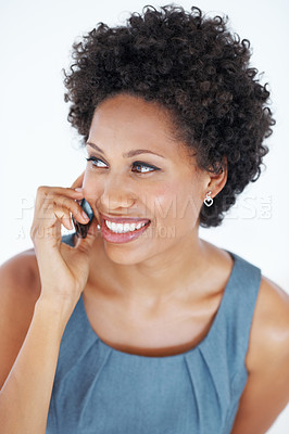 Buy stock photo Smiling African American woman speaking on mobile phone on white background