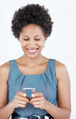 Buy stock photo Smiling attractive business woman text messaging on mobile phone over white background