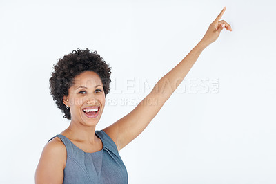 Buy stock photo Beautiful African American business woman pointing at something interesting over white background