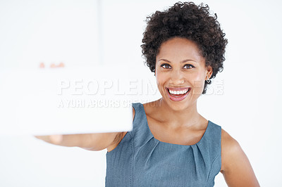 Buy stock photo Beautiful African American business woman smiling while displaying blank card