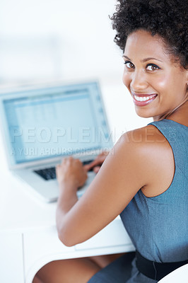 Buy stock photo Portrait of smiling female executive working on laptop