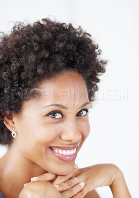 Buy stock photo Closeup of young African American business woman smiling with hands on chin