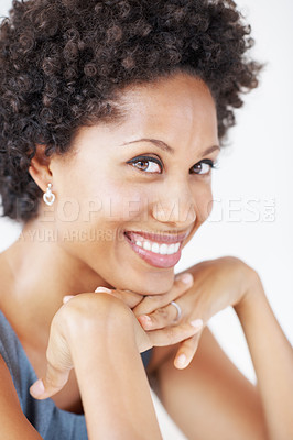Buy stock photo Portrait of pretty business woman smiling over white background with hands on chin