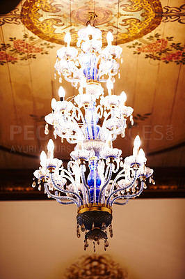 Buy stock photo Intricate chandelier hanging from a ceiling with flowers painted on it