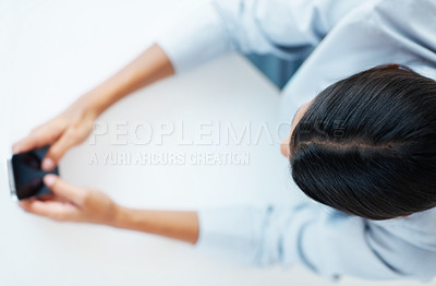 Buy stock photo Top view of mixed race business woman texting on mobile phone