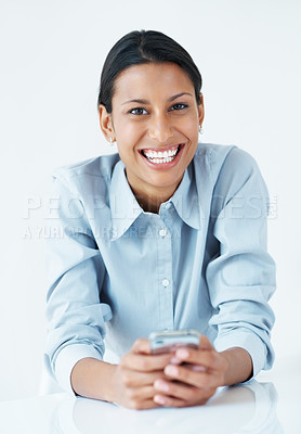 Buy stock photo Happy business woman texting on mobile phone at desk