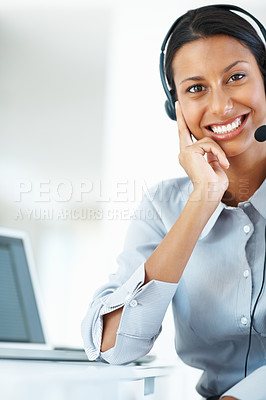 Buy stock photo Portrait of pretty mixed race call center employee smiling at office desk