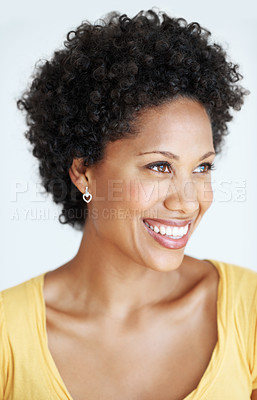 Buy stock photo Closeup of beautiful African American woman with curly hair smiling over white background