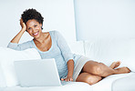Woman using laptop in comfortable apartment