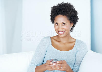Buy stock photo Portrait of beautiful young woman smiling holding mobile phone at home