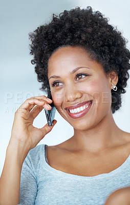 Buy stock photo Closeup of young African American woman smiling during phone call