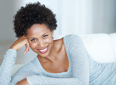 Buy stock photo Portrait of attractive young woman smiling while lying on couch