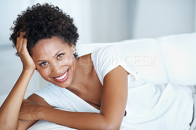 Buy stock photo Portrait of attractive young woman resting on couch at home