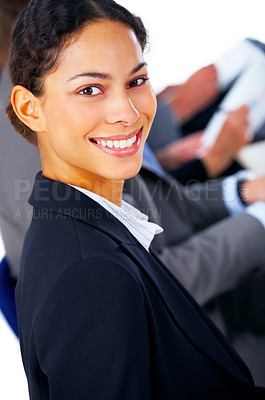 Buy stock photo Closeup of a young smiling business woman at a meeting with his colleagues