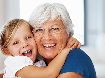 Buy stock photo Closeup portrait of a happy senior woman hugging her cheerful little granddaughter - copyspace