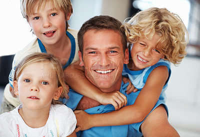 Buy stock photo Portrait of smiling middle aged man having fun with cute children at home