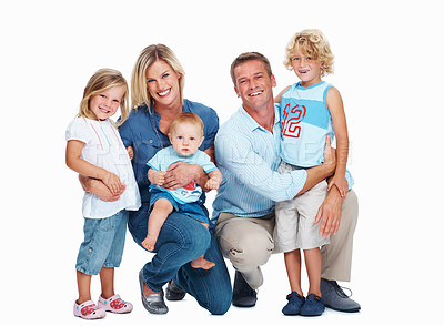 Buy stock photo Portrait of a happy family standing against a white background