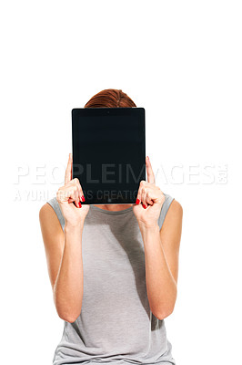 Buy stock photo A young woman holding up the blank screen of a digital tablet