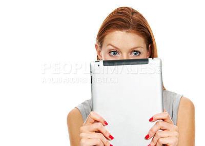 Buy stock photo Portrait of a young woman peering over the top of a digital tablet