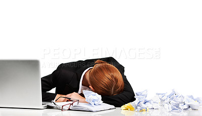 Buy stock photo A young executive having a nap at her desk