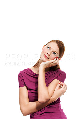 Buy stock photo An attractive woman gazing into the distance while daydreaming