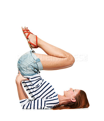 Buy stock photo A young woman in a shoulder stand position on the floor
