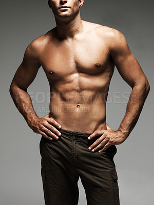 Buy stock photo Cropped image of a handsome young man's upper body