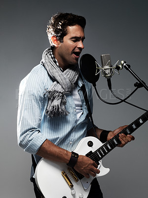 Buy stock photo Handsome young musician recording a song - isolated