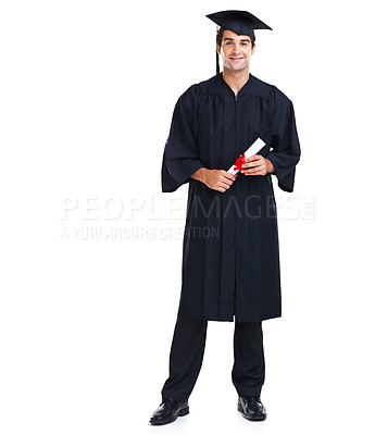 Buy stock photo Proud young graduate wearing a black gown and cap holding his diploma