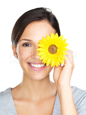 Buy stock photo Beautiful brunette posing with a gerber daisy in front of her eye