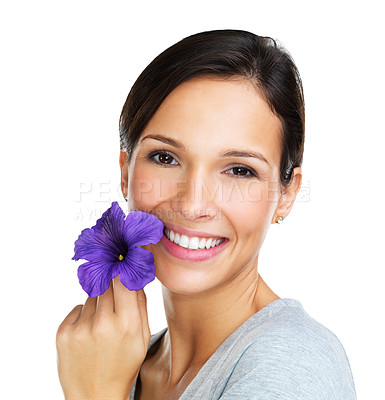 Buy stock photo Lovely brunette holding a purple hisbiscus flower next to her face