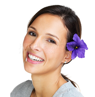 Buy stock photo Stunning brunette smiling at the camera with a purple hibiscus behind her ear