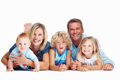 Buy stock photo Portrait of a happy family lying together against a white background