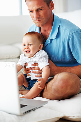 Buy stock photo Cute little baby looking at laptop with father at home