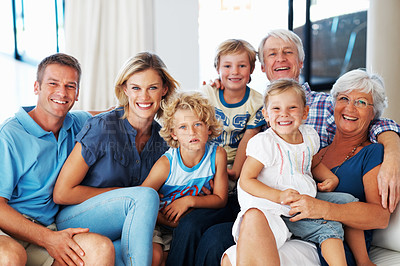 Buy stock photo Portrait of happy multi generation family smiling together on couch