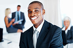 African American business man smiling with colleagues in background
