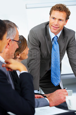 Buy stock photo Young speaker at a business meeting giving a presentation.
