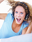 Closeup of a cute young woman enjoying music on headphones