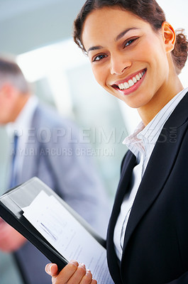 Buy stock photo Closeup of a young smiling business woman at a meeting with her colleagues