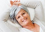 Closeup of smiling elderly woman lying on bed