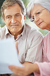 Closeup of a worried couple working on personal finances