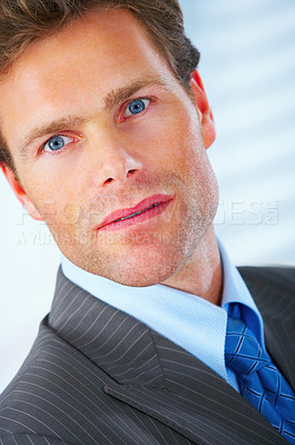 Buy stock photo Close up of a mature and attractive business standing in in his office