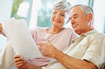 Senior man and woman reading documents