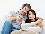 Closeup of mature couple watching television