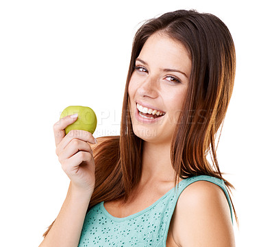Buy stock photo Studio portrait of an attractive young woman eating a green apple isolated on white