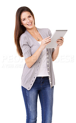 Buy stock photo Studio portrait of a young woman using a digital tablet isolated on white