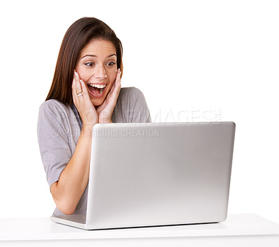 Buy stock photo Studio shot of an excited young woman using a laptop against a white background