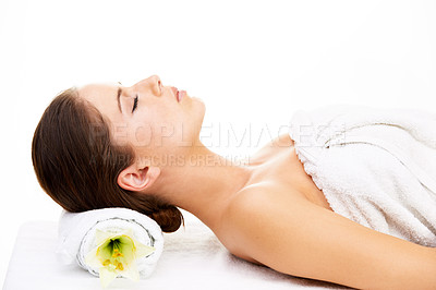 Buy stock photo Cropped shot of a young woman getting lying on a massage bed isolated on white