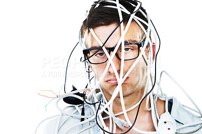 Buy stock photo Studio portrait of a young man with cables hanging over his head isolated on white