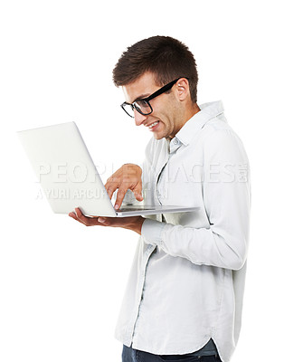 Buy stock photo A nerdy hipster touching the keys on his laptop with a white background